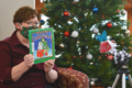 """MARY HOOKHAM The Independent-Register Albertson Memorial Library Director Carolyn Seaver reads """"Max's Christmas"""" by Rosemary Wells for a recent storytime recording. Because of the pandemic, Storytime is posted weekly on the Albany library's Facebook page instead of being held in person."""