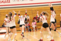 BECKY MALKOW The Independent-Register The Lady Cardinals celebrate a big block in the March 18 match against Evansville. The Brodhead girls swept their opponent 3-0 on their way to a 5-1 start to the alternate spring season.