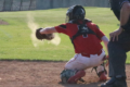 BECKY MALKOW PHOTO The Independent-Register Catcher Connor Green squeezes a third strike for an out in the game against Monroe last week.